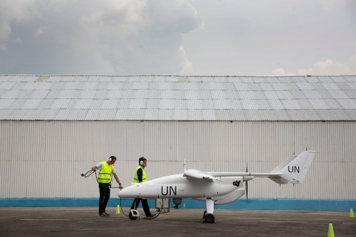 A team of technicians prepare a Falco unmanned aerial vehicle for the inaugural flight in Goma, North Kivu province, during an official ceremony organized in the presence of Under Secretary General for Peacekeeping Operations, Herve Ladsous, on 3 December 2013.