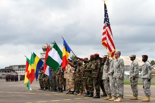 Representatives from the militaries of Burundi, Cameroon, Republic of Congo, Gabon, Netherlands, Nigeria, Chad and the United States participate in the opening ceremony for Central Accord 2014 in Cameroon on 11 March 2014.